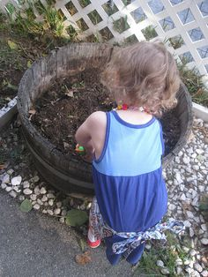 When Greta expressed an interest in gardening, Christine was more than happy to clean up our old container garden and start fresh. As you can see from the pics, Greta has her mother's green thumb!