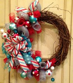 Christmas Grapevine Wreath by PurplePetalDesign, $75.00 one etsy. Seller states: Whimsical fun and funky designer Christmas Wreath! A grapevine wreath base is adorned with silver and red DecoMesh curls, Polk a dot Christmas balls in old time style Christmas colors of red, white, and winter blue surround a gorgeous large striped ribbon bow. Would make a beautiful addition to your front door, fireplace, or and wall!""