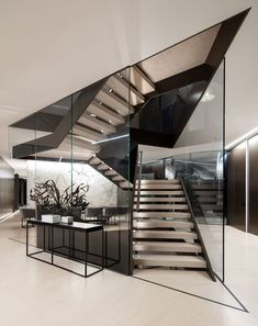 The Orum Residence by SPF:architects A large and sculpture staircase made of metal and glass is central to this modern house. The Orum Residence by SPF:architects A large and sculpture staircase made of metal and glass is central to this modern house. Glass Stairs Design, Home Stairs Design, Modern House Design, Modern Interior Design, Interior Architecture, Home Design, Design Ideas, Design Design, Modern Interiors
