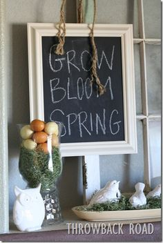 spring mantle with homemade chalkboard, great idea for hurricane vase.