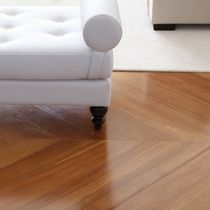 IndusParquet Brazilian Hardwood Floor shown in a herringbone pattern. This hardwood flooring looks great in any home decor and won't ever go out of style.