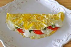 2 teaspoons olive oil  1 egg + 1 egg white*  half a plum tomato, thinly sliced  1 oz fresh mozzarella cheese, thinly sliced  1-2 leaves of basil