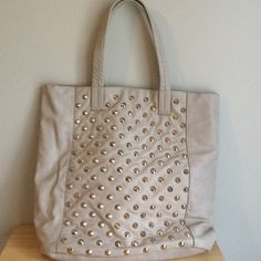 Cream Tote Fashionable tote... take it anywhere! Amazing spike details. Almost new! Urban Outfitters Bags Totes