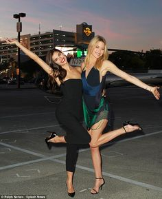 Hanging on the heli-pad: As the sun set, Sara and Martha struck exaggerated poses before t...