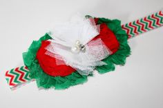 This is such a beautiful Christmas headband! It has shabby flowers in red and green with a white tulle flower on red, green, and white headband.