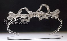 A rhinestone tiara in the shape of a dog bone connected to a bow. (Vivienne Westwood) Source by juli Diamond Bows, Diamond Tiara, Art Deco Diamond, Diamond Ice, Bow Jewelry, Jewelery, Fine Jewelry, Jewelry Design, Royal Jewels