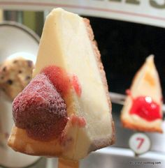 Frozen cheesecake next to its plastic version for comparison