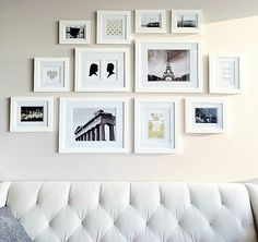Gallery wall with white frames (via Hey There Home).
