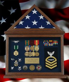 Cindy's Custom Framing & Antique Art Example of custom framed navy shadow box inside a flag case. This is a great way to show off a military career. Visit our website for more framing ideas http://cindysantiqueart.com