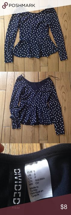 Navy polka dotted peplum shirt This navy blue shirt has white polka dots. It is a peplum styled long sleeve shirt. The shirt swoops down in the back. In great condition 💙 H&M Tops Tees - Long Sleeve