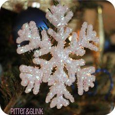 Made with hot glue! One person said to sprinkle epsom salt for a crystal effect! Under The Table and Dreaming: Hot Glue Glittered Snowflake Ornaments featuring Bethany from Pitter & Glink {Handmade Ornament by bettie Christmas Ornaments To Make, Christmas Snowflakes, Homemade Christmas, Christmas Crafts, Christmas Decorations, Holiday Decor, Diy Snowflakes, Christmas Tree, Snowflake Craft