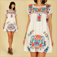 ViNtAgE 70's White Floral Mexican Hand Embroidered MiNi Dress Tunic. $58.00 USD, via Etsy.