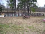 My kennels with the training pond, also where I raise the bait that I fish on Toledo Bend with.