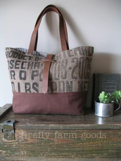 burlap coffee sack tote by firefly farm goods These are awesome! I totally want to make one of these. Burlap Purse, Burlap Bags, Hessian, New Handbags, Tote Handbags, Coffee Bean Sacks, Burlap Coffee Bags, Diy Sac, Sack Bag
