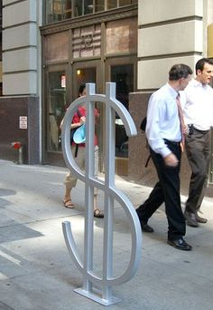 Wall Street Bike Rack (he designed different ones to correspond to the racks placement like this on in Wall Street)