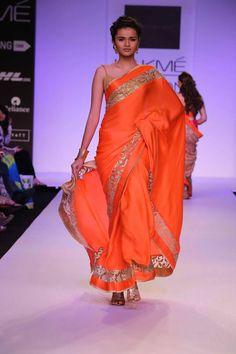 Mandira Bedi Lakme Fashion Week Summer 2014 red sari. More here: http://www.indianweddingsite.com/mandira-bedi-lakme-fashion-week-summer-resort-2014/