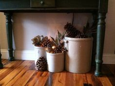 Under the entry way table! love to fill my crocks with seasonal decor. Pinecones, wintry picks, and a strand of lights really makes this a cozy little nook French Home Decor, Fall Home Decor, Autumn Home, Cheap Home Decor, Antique Crocks, Old Crocks, Farmhouse Christmas Decor, Farmhouse Decor, Country Decor