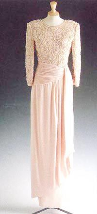 Designed by Catherine Walker. Pink chiffon evening dress with the bodice embroidered in a paisley style in simulated pearls.  Diana wore this gown in Pakistan in 1991 and on several other occasions including a visit to a performance of the Royal Variety  $51,750.00 Purchased by Disney animators Pam and Mark Henn from Florida to raise money  in honor of Disney animation fan Erin Pincus. Sadly Erin died five years later after surgery for a malignant brain tumor.