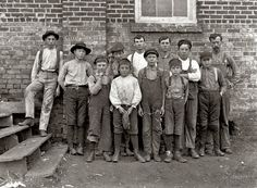 """December 21, 1908. Newton, North Carolina. """"More youngsters in Newton Cotton Mills. Out of 150 employees there were 20 of these boys and girls."""" Photograph by Lewis Wickes Hine."""