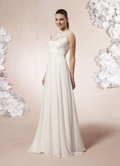Beautiful flow to this bridal dress has short sweep train. Sweetheart style 5983 A lace and tulle sheer Bateau neckline, with a chiffon ruched cummerbund  at the empire waist line, on a chiffon full A-line skirt. Buttons  fasten the sheer lace and tulle neckline, and cover the back zipper.
