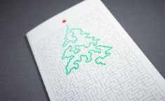 Christmas Tree grows through a maze, smart & funny greetings card