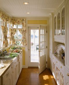 "now thats a great galley kitchen Love this sweet cottage kitchen!Rosecliff is an old sea side cottage perched on a bluff that originated as a fishing ""shack"". It was renovated into a charming southern seaside cottage."
