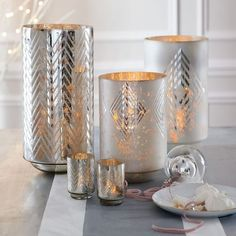 A light frost. Use these subtly patterned Frosted Deco Mercury Hurricanes to set a festive winter centerpiece or dress up your mantel.