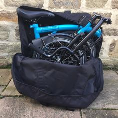 This makes packing away your Brompton whilst on public transport really easy. You can treat it as normal luggage until you get to your destination and then pack it away on your Brompton. Weight: 854 gramsDimensions: wide x 59 high x deep Best Carry On Backpack, Best Carry On Luggage, Hand Luggage, Backpack Bags, Carry On Size, Folding Bicycle, Bike Storage, Brompton, Cool Backpacks