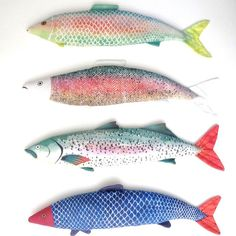 fish stuffed animals... Could sew them in white fabric then paint them...