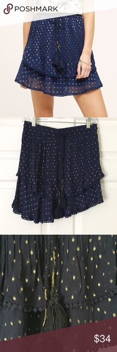 "Anthropologie TryB Primrose Gold and Navy Skirt Anthropologie TryB Primrose skirt in navy and gold. Viscose, mini swing silhouette, pull on with drawstring waist. 17.5"" long. Size M. Excellent used condition save for minor unraveling on one drawstring- see photos. Anthropologie Skirts"