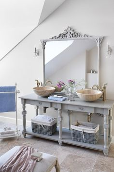 How beautiful is this mirror! Love the sinks too and I like the look if the vanity but realistically only a guest bath could work with open storage in my home.