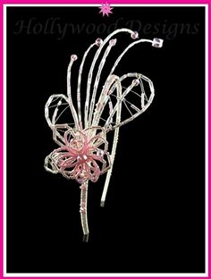 Talulah Silver Pink Tiara - This cute tiara is designed on the 1920's era. A pink and silver treble flower made up with Swarovski crystal elements and delicia beads adorned with silver leaves topped with swoops of wire beads giving a 20's style look to this dainty tiara. Can be made up in the colour of your choice.