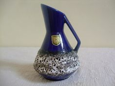 A vintage and highly collectible West German fat lava vase by Fohr Keramik.  Standing at 12 cm high, this eye-catching vase is a thing of