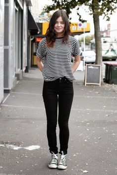 Sneakers outfit: Striped top, black jeans and black converse.