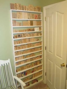 storing stamps behind a door on simple shallow strip shelving. Brilliant use of dead space, and it makes them easy to see and find.  This would also work for dozens of other items: books, craft supplies (paint, glue, glitter, ribbon), gift wrap, LEGO minifigures, Barbie display, etc.  The possibilities are endless!  I love it!