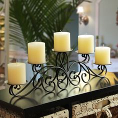 This beautiful, table top candle holder is safe and sturdy, and holds five pillar candles in an arched shape. A wide base of scrolled iron prevents it from toppling over, and wide plates for each candle keep wax drippings from ruining your furniture.