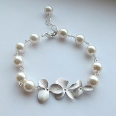 $30 Swarovski White Pearl and Orchid wire wrapped bracelet.
