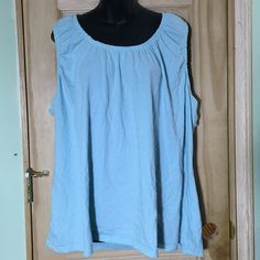 100% Cotton Light Blue Tank Top plus size 4X This tank top has the cutest tapering around the collar! It comes in a light blue color and is from the brand Merona and size 4. In excellent pre-worn condition. Merona Tops Tank Tops