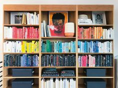 Color-coded dream bookshelves from The Home Edit Life! #bookshelves #colorcoded #thehomeedit #rainbow #homeedit Bookshelf Styling, Bookshelves, Upcoming Netflix Series, Holiday Storage, The Home Edit, Getting Organized, Home Organization, Old Photos, Pet Supplies