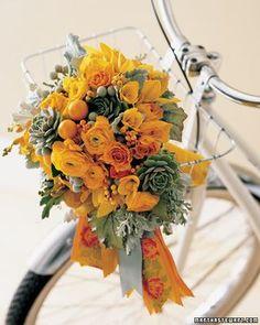 Orange ranunculus bouquet with a vintage style orange and grey ribbon