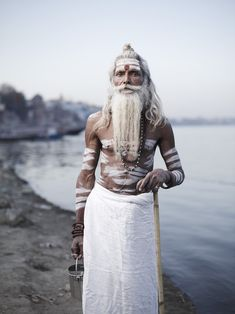 PORTRAIT OF BABA VIJAY NUND by Joey L.  Baba Vijay Nund outside his ashram on the banks of the Ganges River. Varanasi, India