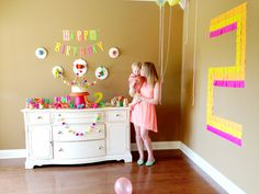 neon 2nd birthday...lots of creative party decor using simple materials, like Post It Notes, spray-painted plastic animals, craft paint, tissue paper and pom poms  | 100 Layer Cakelet