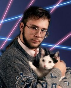 Awful Portrait. It's from the 80's, but it's terrible. The lights in the background, him holding that cat, his outfit.