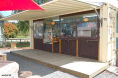 Shipping container cafe, like concept of hinged side to provide a verandah