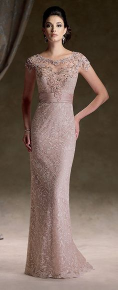 Venise lace and satin sheath with scalloped cap sleeves, intricate hand-beaded illusion bateau neckline and open back bodice, sweetheart bodice with pleated satin empire waistband.