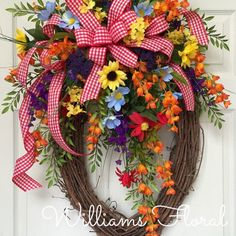 Bright Spring and Summer Oval Grapevine Wreath by WilliamsFloral on Etsy https://www.etsy.com/listing/227460832/bright-spring-and-summer-oval-grapevine