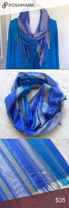 🆕Blue striped scarf Beautiful striped scarf in shades of blue, purple, white, and pale yellow, with shimmery gold woven in. Alternating open weave. Excellent condition! Top also for sale in my closet. NO TRADES! Accessories Scarves & Wraps