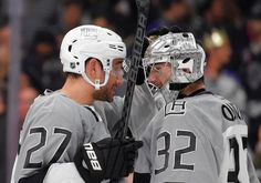 Los Angeles Kings defenseman Alec Martinez, left, congratulates goalie Jonathan Quick after they defeated the San Jose Sharks 4-1 in an NHL hockey game, Saturday, April 11, 2015, in Los Angeles. (AP Photo/Mark J. Terrill)
