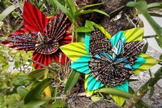 Orchid origami flower by Sabbatha Rahzuardi, visual design artist from Bali, Indonesia.
