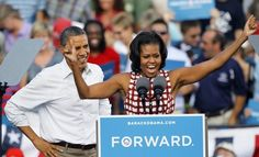 First lady Michelle Obama gets the crowd excited for her husband President Barack Obama during a campaign stop Wednesday, Aug. 15, 2012, in Davenport, Iowa. [AP Photo]